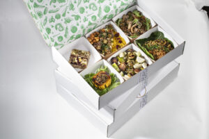 Six dishes in a six-compartment bento box